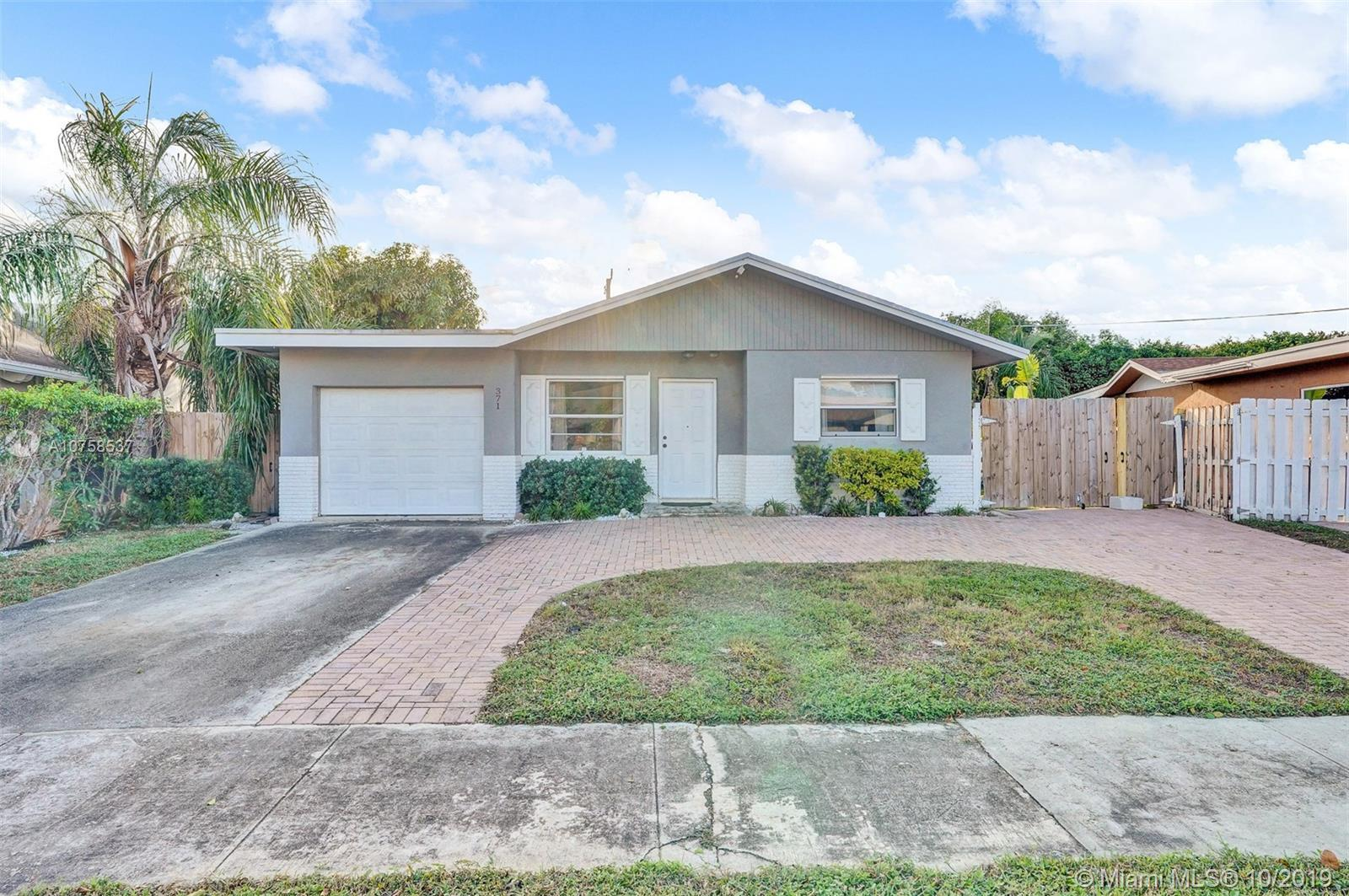 Fantastic 3 bedroom home on an oversized lot! This spacious interior has generous living spaces, til
