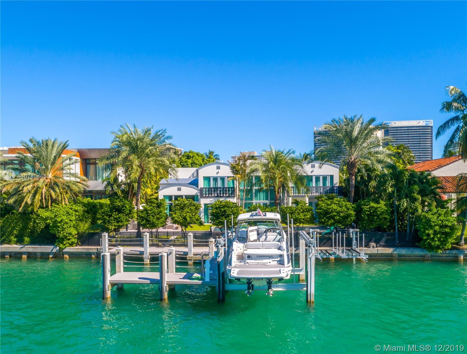 Unique contemporary waterfront home located in at the prestigious Bal Harbour Village with only 31 H