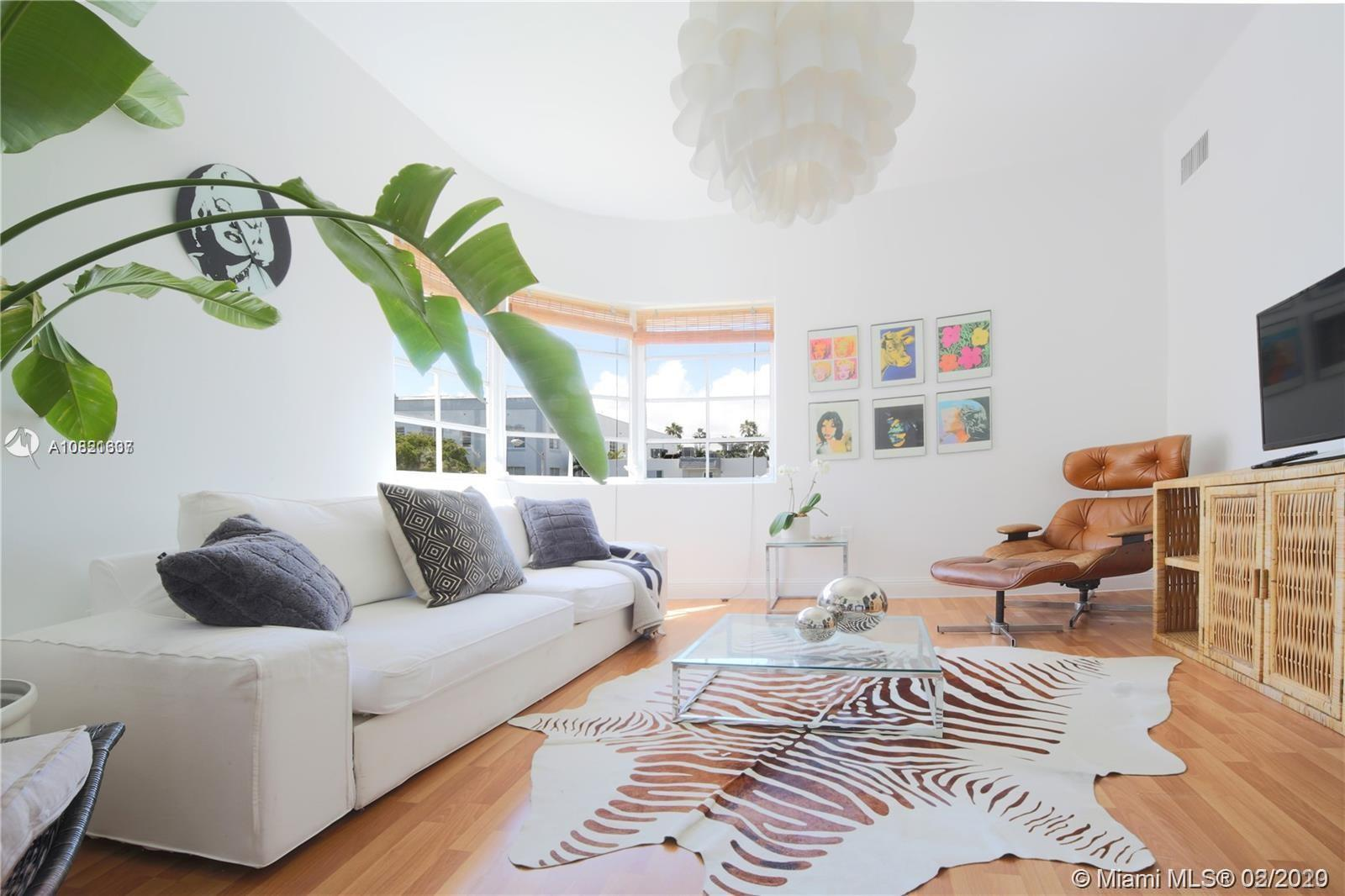 Charming 2nd Floor Deco Condo Steps to Beach. Large 1 bedroom with lots of light and nice Deco round
