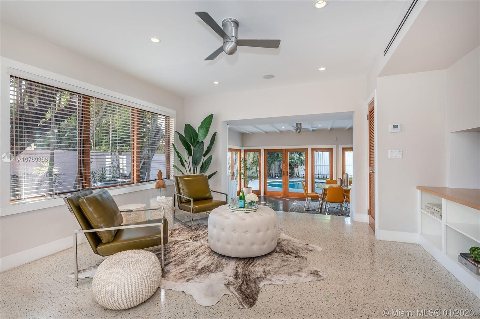 Completely renovated 2-story, 2500 SF modern Surfside home with heated pool and impact windows throu