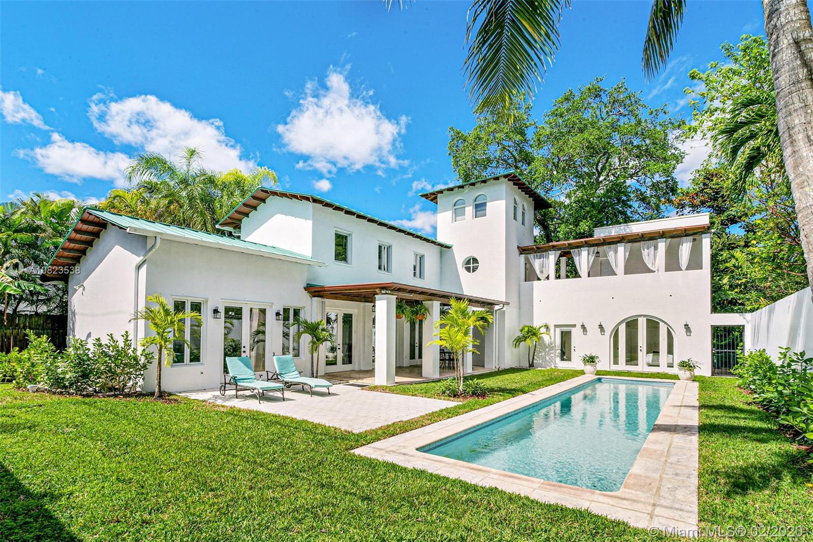 Updated elegant, majestic 3 story 5bdrm/4 bath courtyard villa sits behind a walled & gated main ent