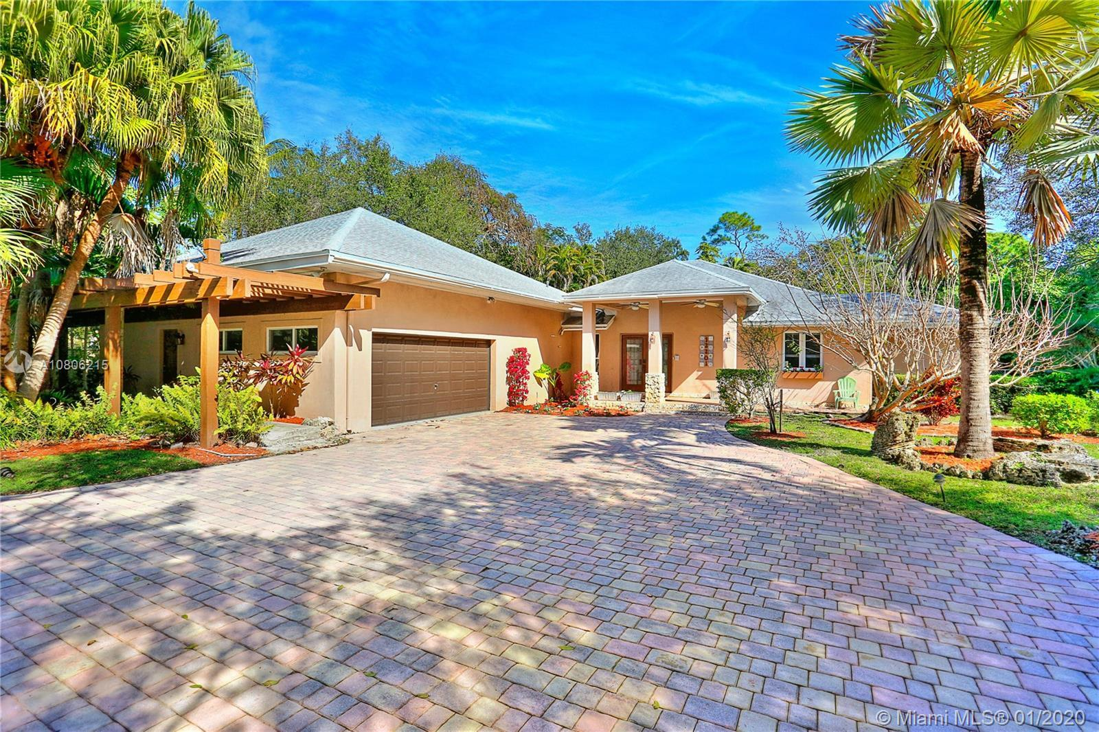 Located on a picturesque tree-lined Pinecrest street, this beautiful and light-filled 4 bed / 4.5 ba
