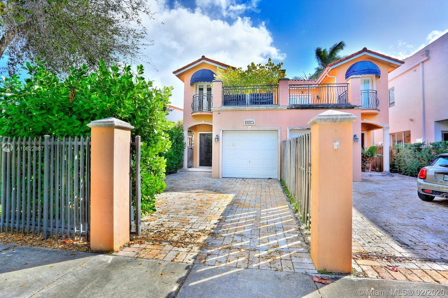 Lovely, gated townhouse on a quite street in Coconut Grove. Walk to the Grove village center's galle