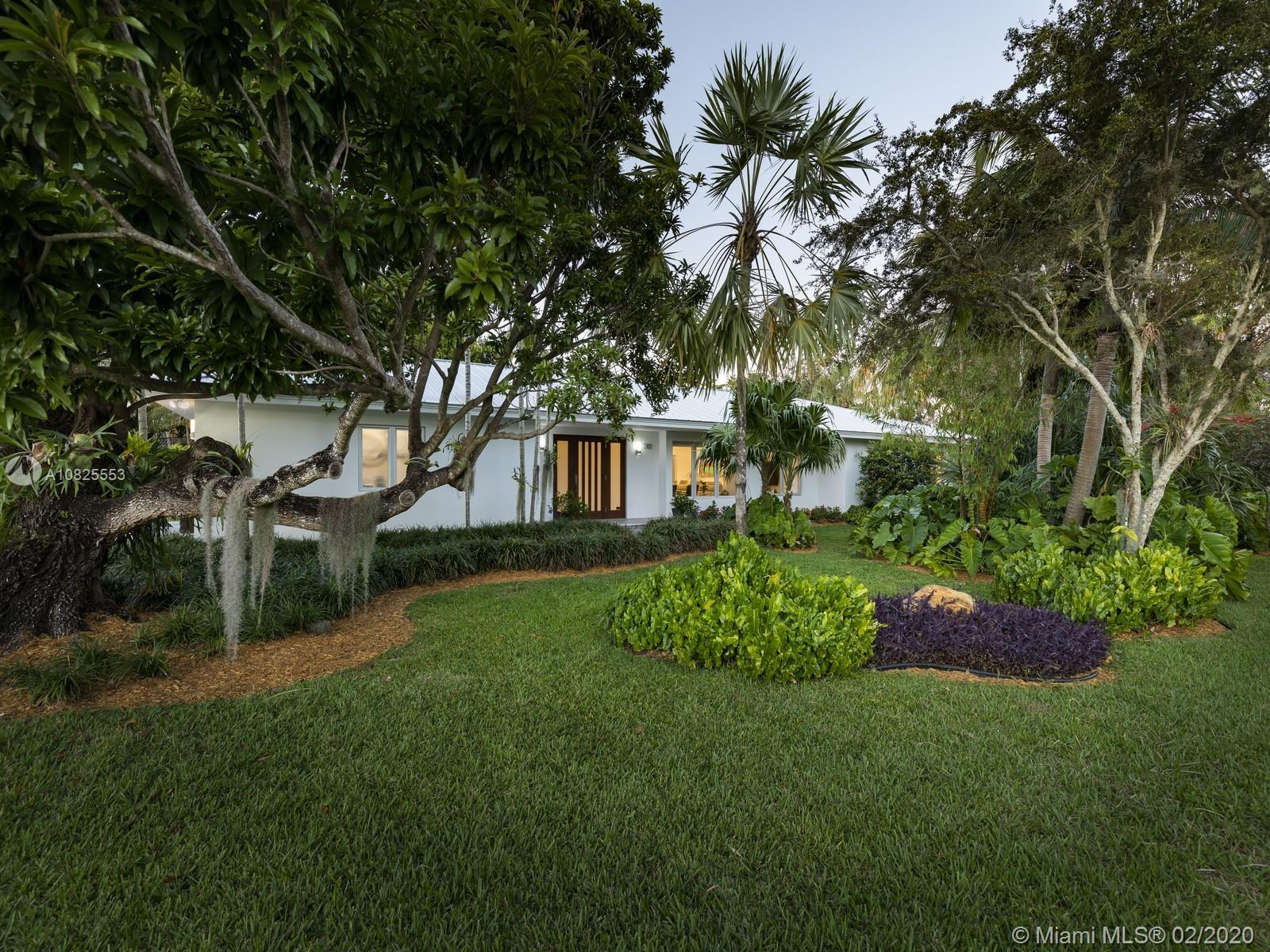 Balmy tropical glamour meets harmonious family living inside this completely rebuilt in 2016 estate.