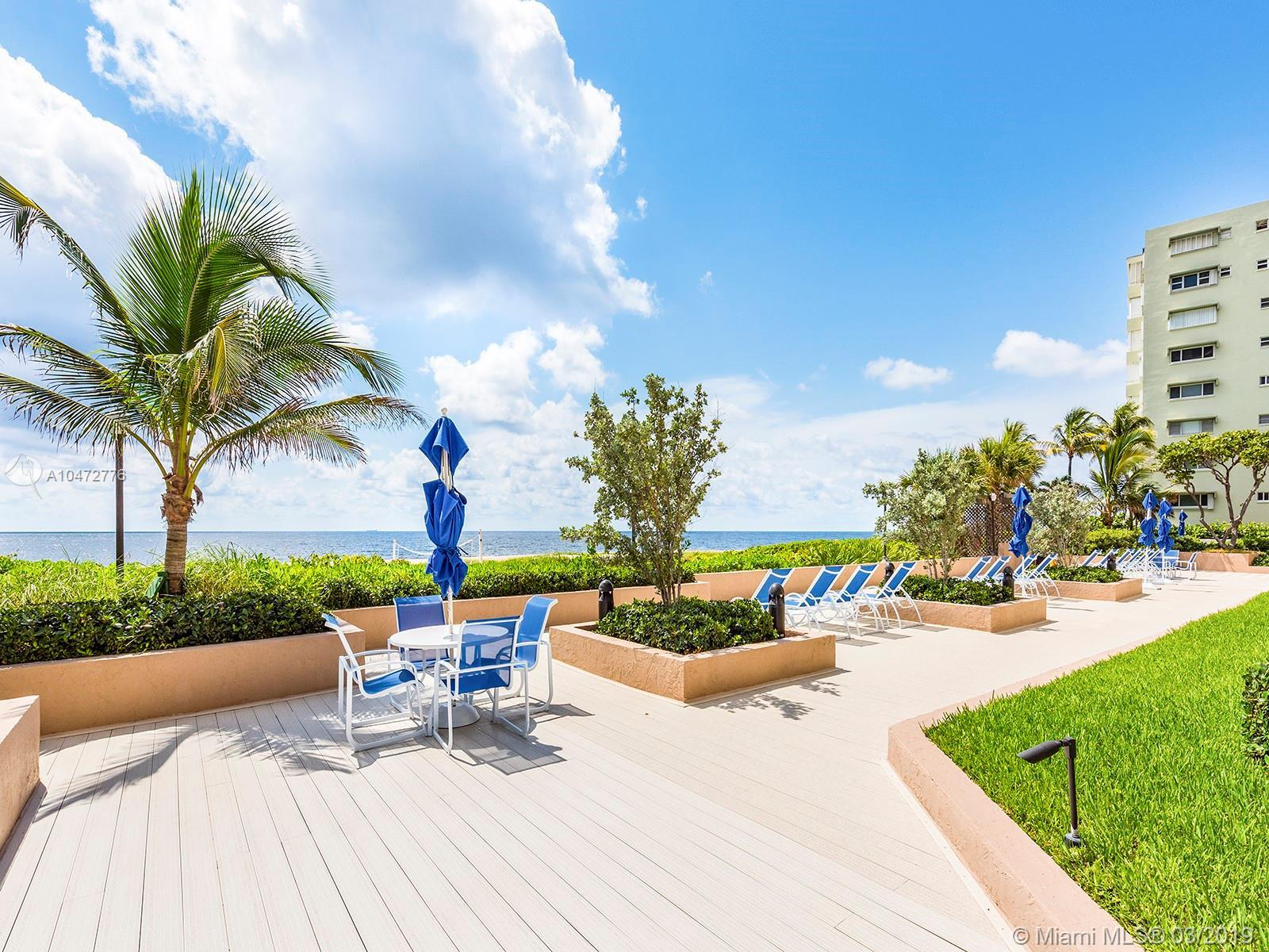 Steps to the sea from your patio! First floor condo with lush landscaping. Relax and watch the sunri