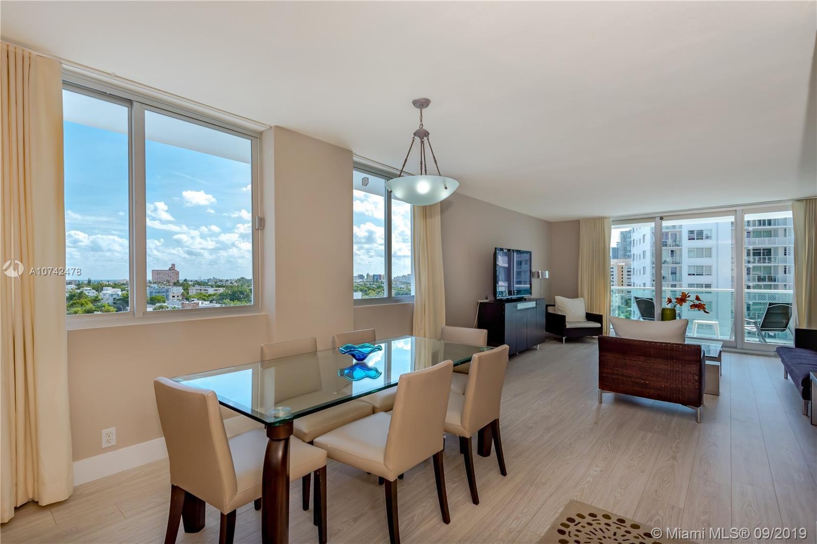 Beautiful 2 bedroom 2 bath apartment with recently installed windows and sliding glass door on trend