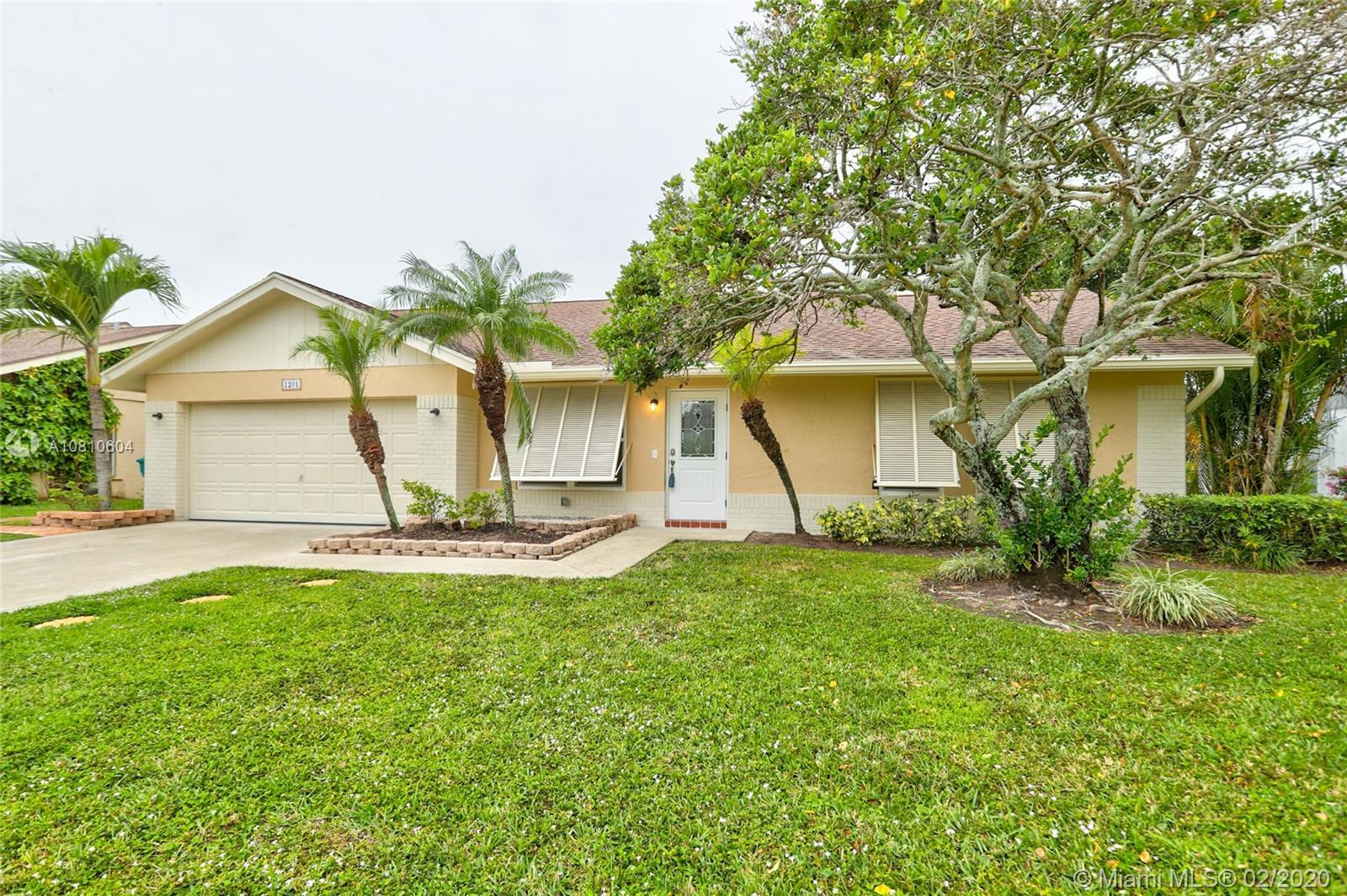 Captivating 4 bedroom, 2 bathroom single family home located in the coveted neighborhood of Sky Lake