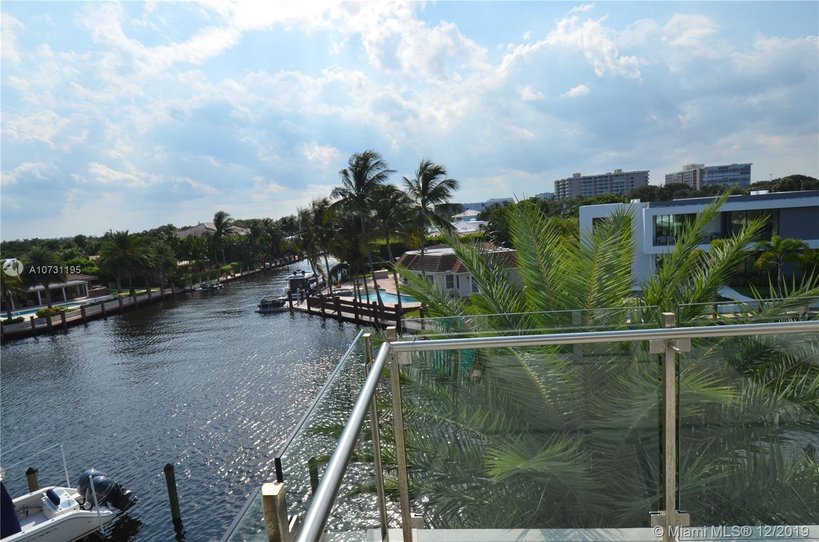 Luxurious Waterfront Corner Townhouse w/ rare opportunity to own one of the few remaining large priv