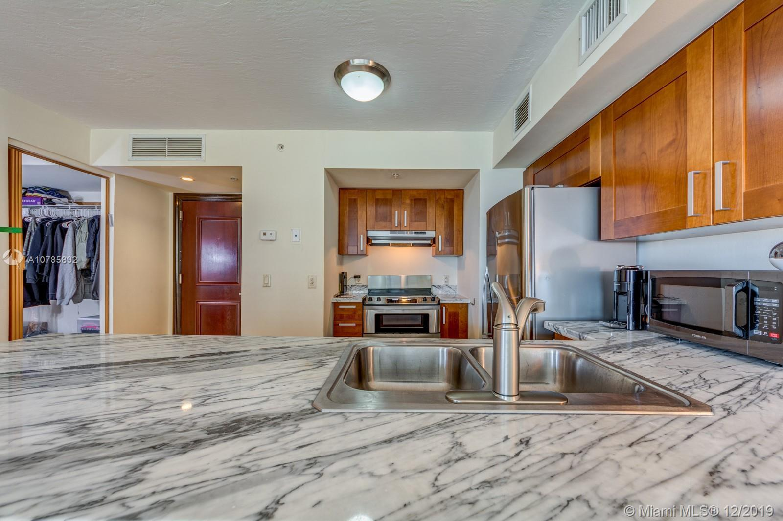 Very rare CORNER residence- only a few unit offer 2 BALCONIES. Beautiful SW Exposure. Spacious open
