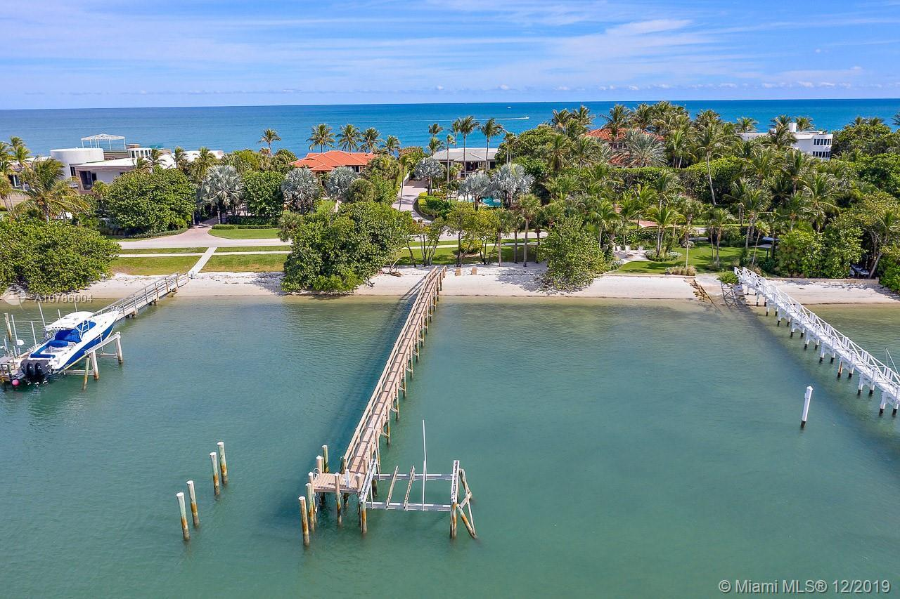 Surrounded by blue water and beaches on both sides, this OCEAN TO INTRACOASTAL property located on t