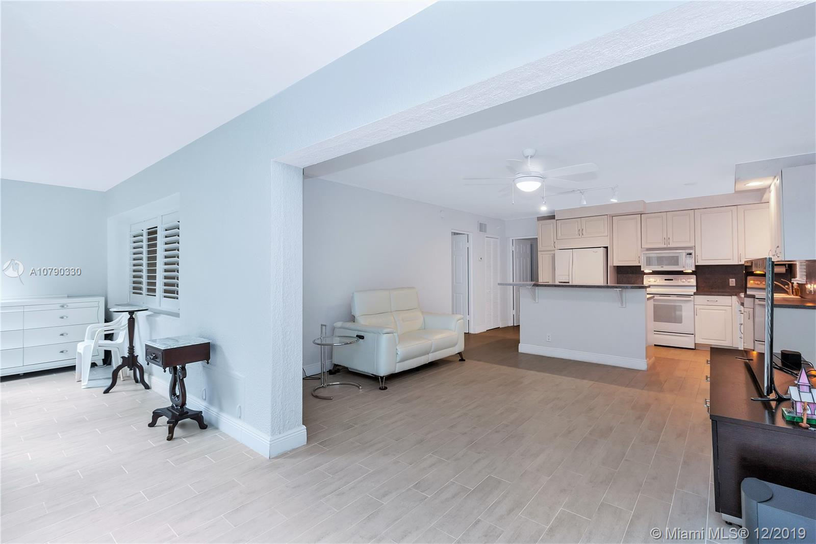 Beautifully remodeled and highly sought after renovated 2 bedroom 2 bath corner unit. Amazing Location! Walk just one block to Las Olas. Enjoy living right on the water, watch the boats and super yachts driving by. Spacious and open floor plan with new flooring. Lots of natural sunlight with a light and airy feel. Renovated bathrooms. Hurricane impact windows and doors all throughout. Peaceful Garden style Complex features a tranquil courtyard with a private pool. Catch the water taxi right next door! Enjoy world class shopping, fine dining , and all that Fort Lauderdale has to offer!
