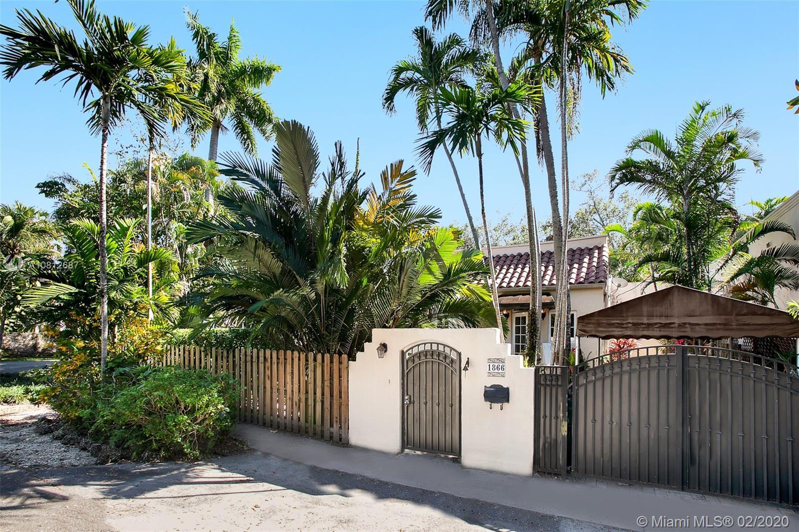 Nestled on a corner lot in a prime N Grove neighborhood, this Old Spanish-style home has been comple