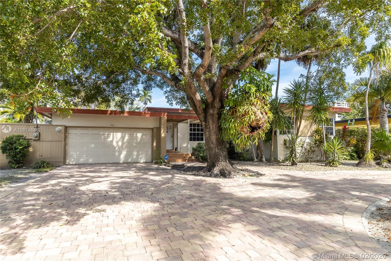 Miami Shores, mid-century 2/2 with a pool and 2 car garage. 75' on the canal with a dock and no fixe