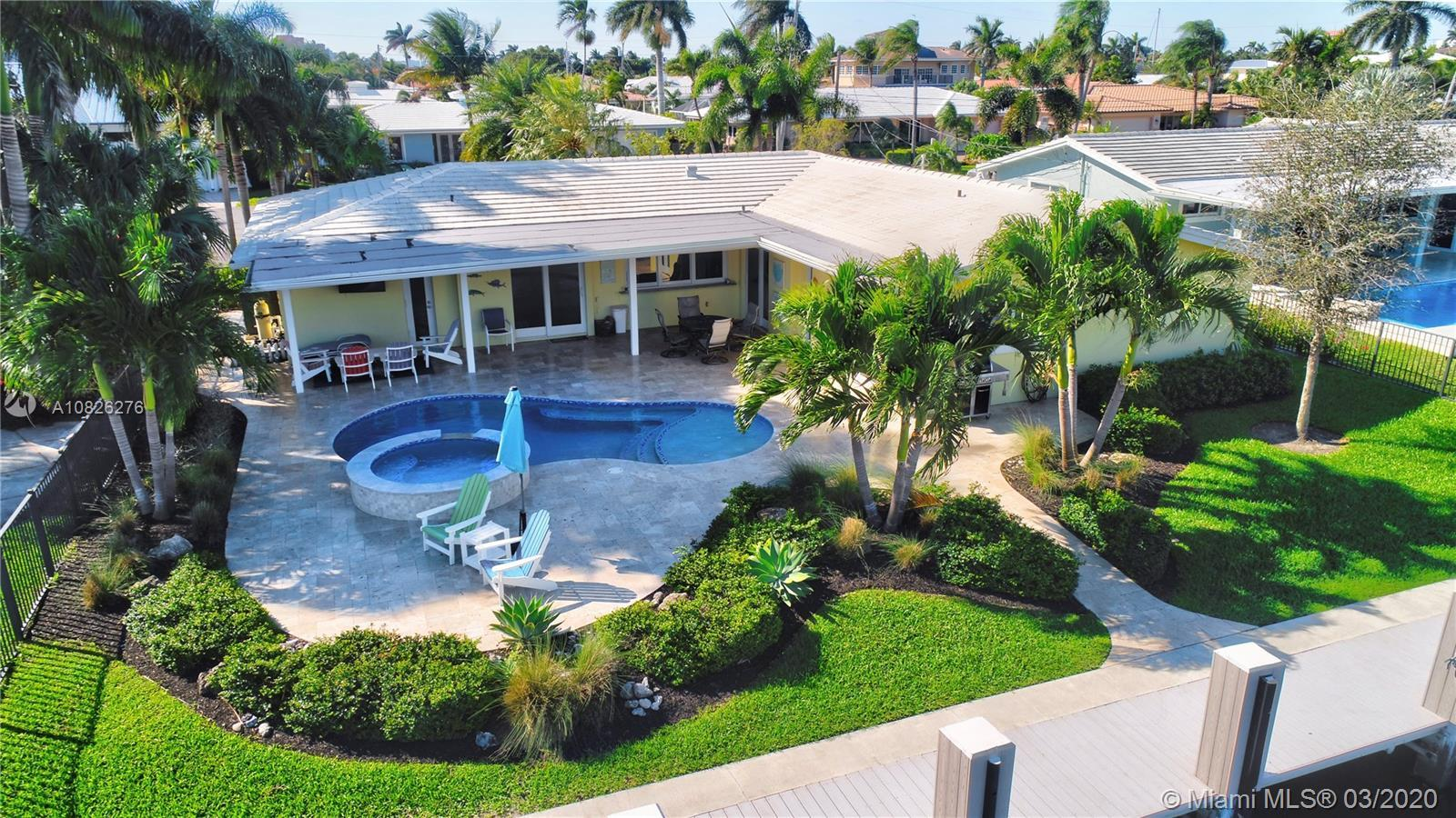 This exceptional waterfront home was completely re-designed & remodeled using the finest materials,