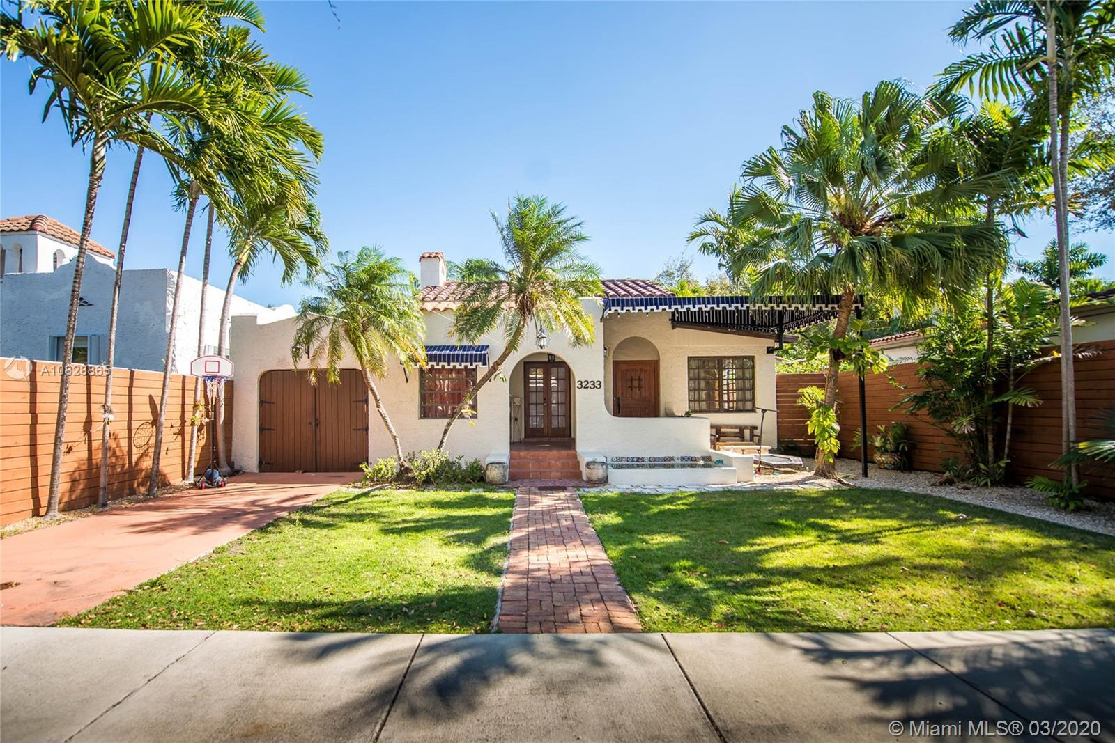 Lush and Beautiful authentic Florida home,  nestle on a high point in Miami (non-flood zone). Spanis