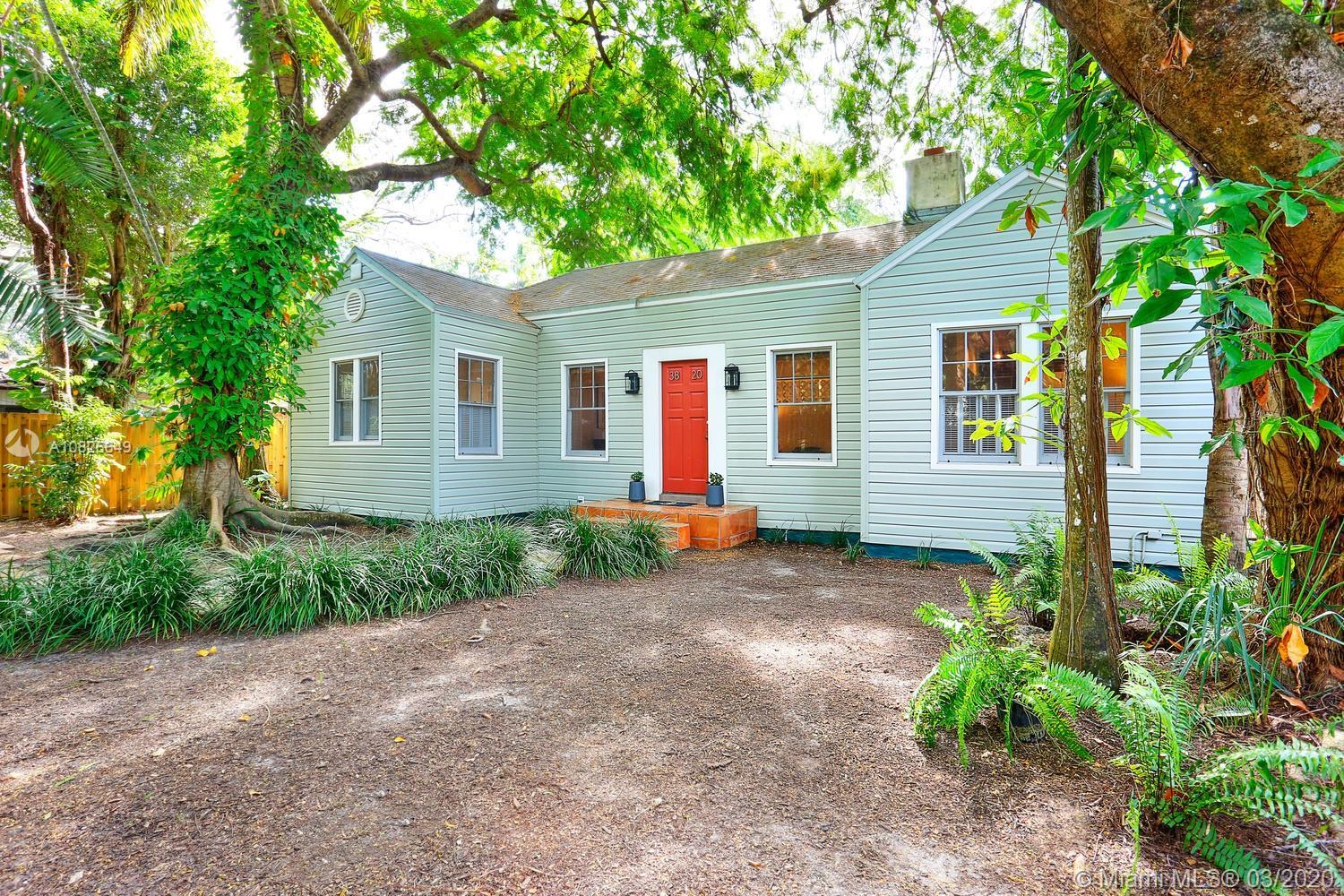 Quintessential Grove bungalow + 2-story guest house, tucked behind a privacy fence & surrounded by a