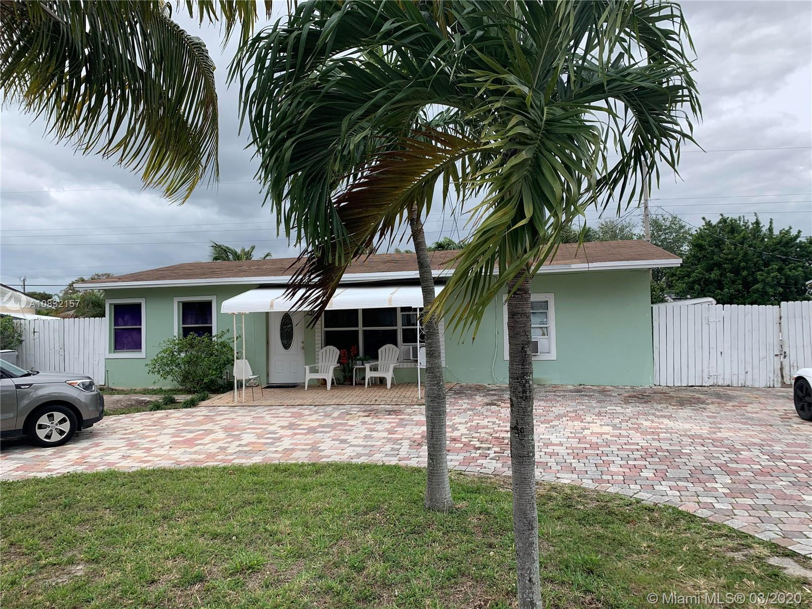 Immaculate 3/2 home in Pompano Beach; in law unit with kitchen and bath that can be used as an effic