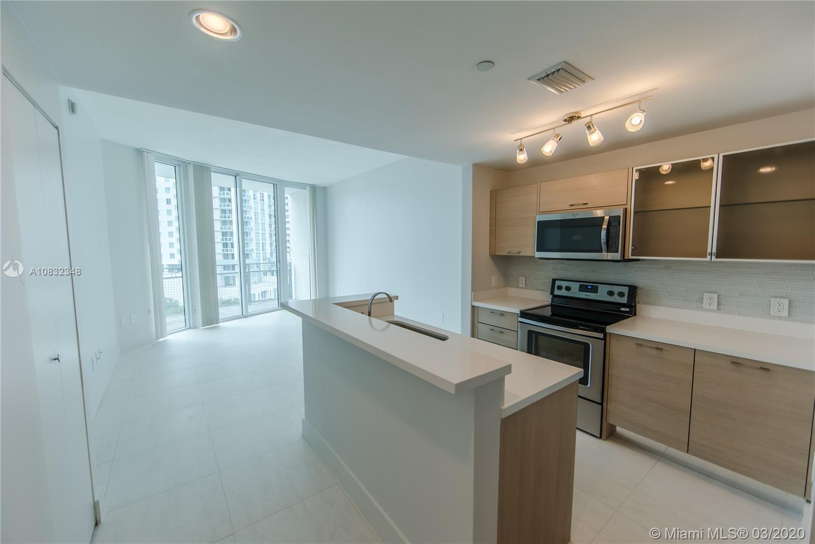 Live in the middle of it all! This 2 bedroom 2 bath unit is ready to move. Building amenities includ