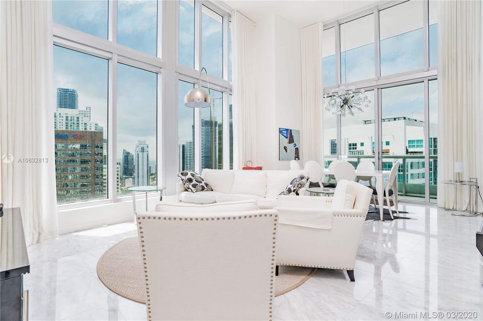 Rare corner unit in W Hotel Residences with 16 ft ceilings and best views of Miami and Biscayne Bay.