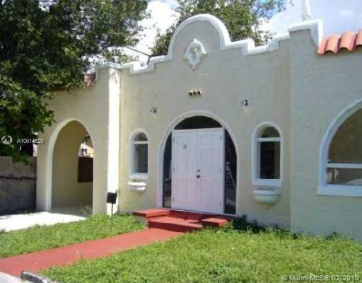 Design District Pool home with 3 bedrooms and 2 bathrooms. This property features an enclosed front