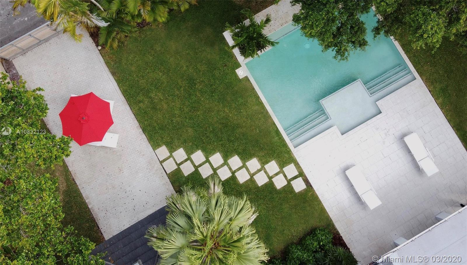 MIAMI SHORES MODERN OASIS custom designed for INDOOR/OUTDOOR LIVING & ENTERTAINING. Situated on spra