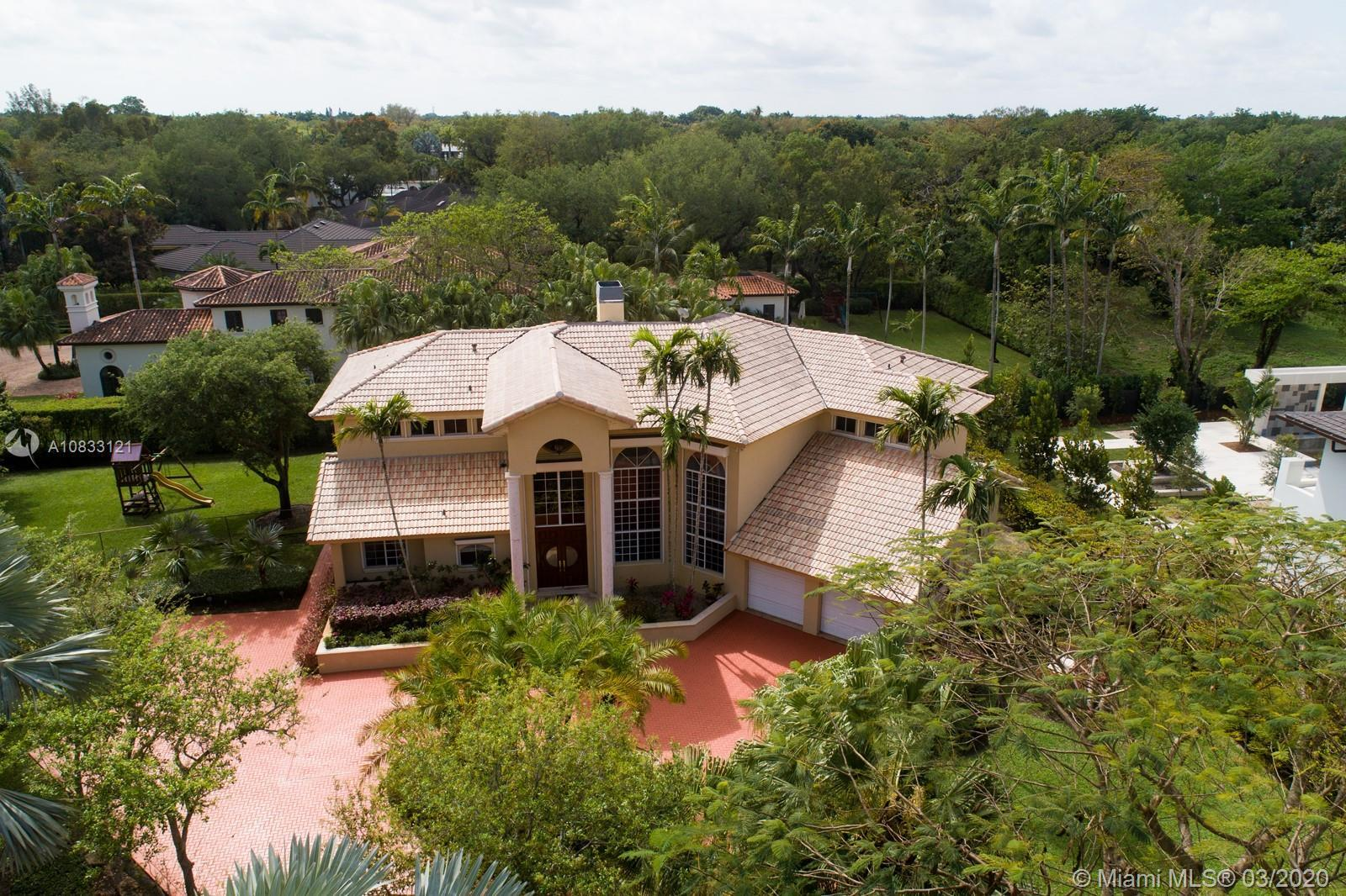 PRIME PINECREST LOCATION! Set back from the street in North Pinecrest and surrounded by manicured ga