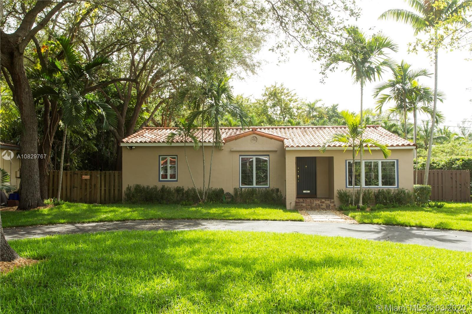 This charming South Grove bungalow boasts an over sized master bedroom w/ dual sinks in master bath,