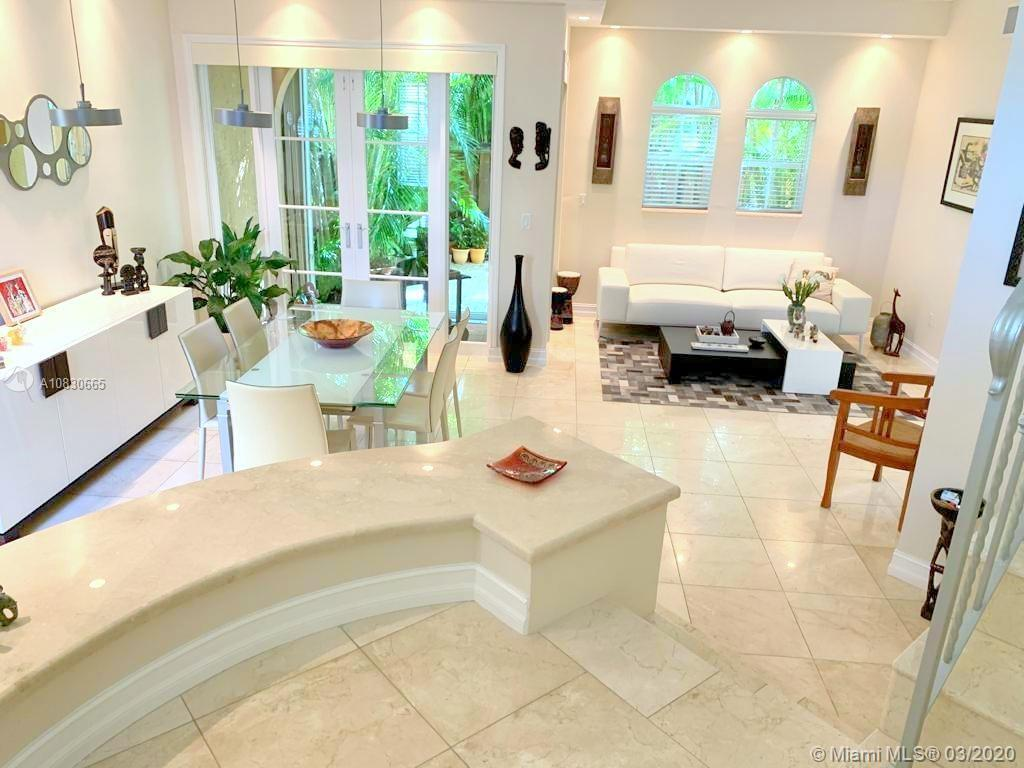 STUNNING MEDITERRANEAN STYLE TOWNHOUSE in UPSCALE AVENTURA BAY, Beautifully RENOVATED with MARBLE FL