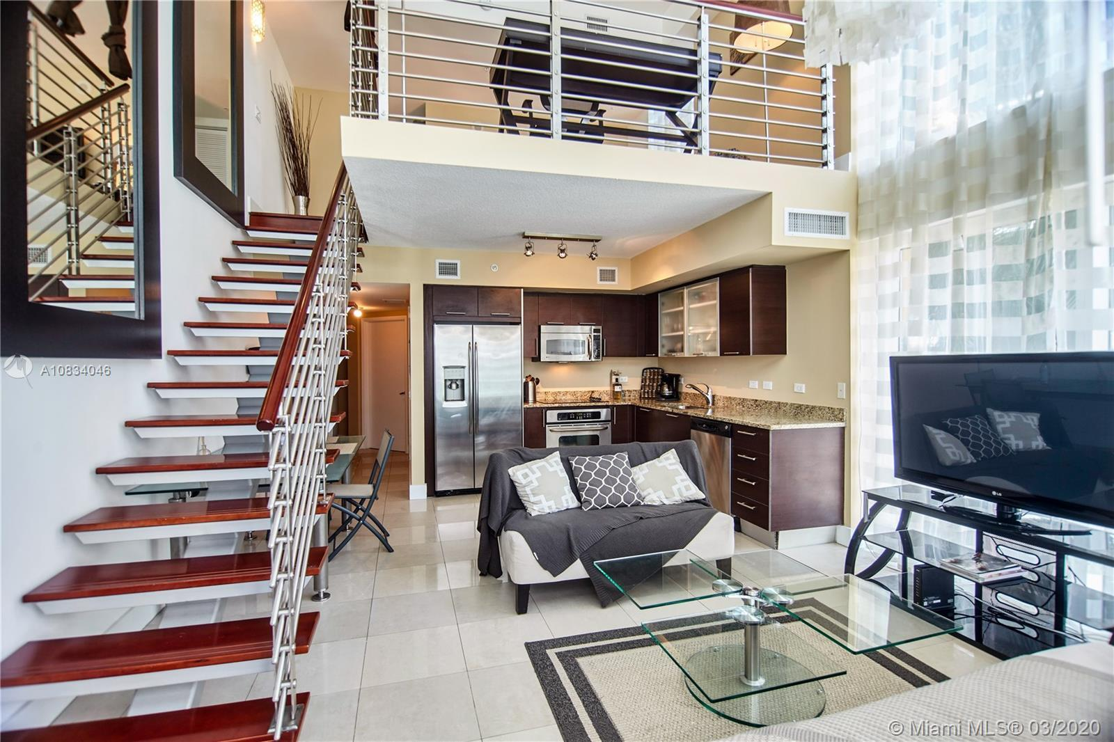 Stunning fully furnished 2 bedroom - 2 bath  - 2 level loft style Brickell on the River South Tower