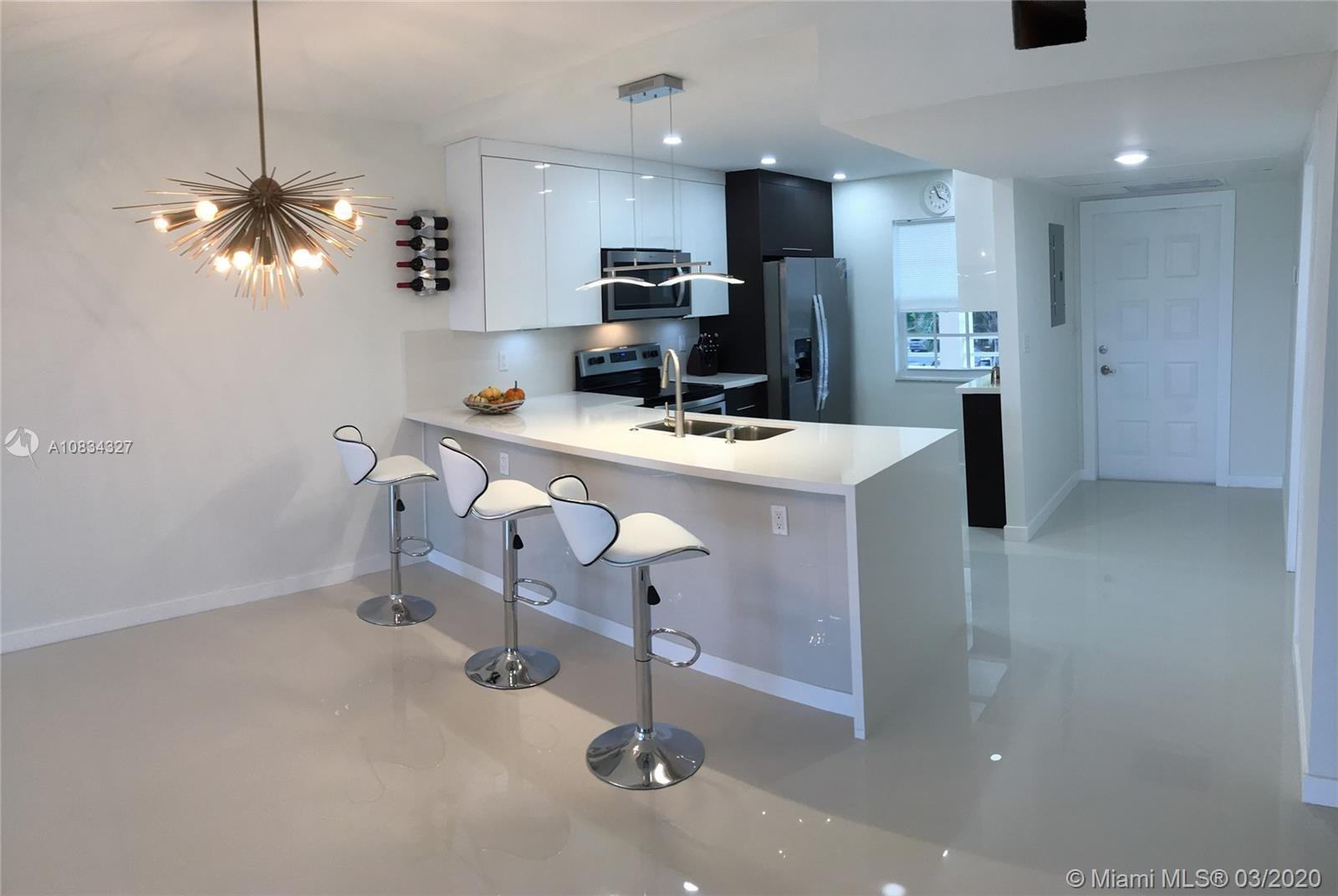 COMPLETELY REMODELED 2 BED-2 BATH APT LOCATED IN THE HEART OF PALM AIRE. TOP OF THE LINE MATERIALS W