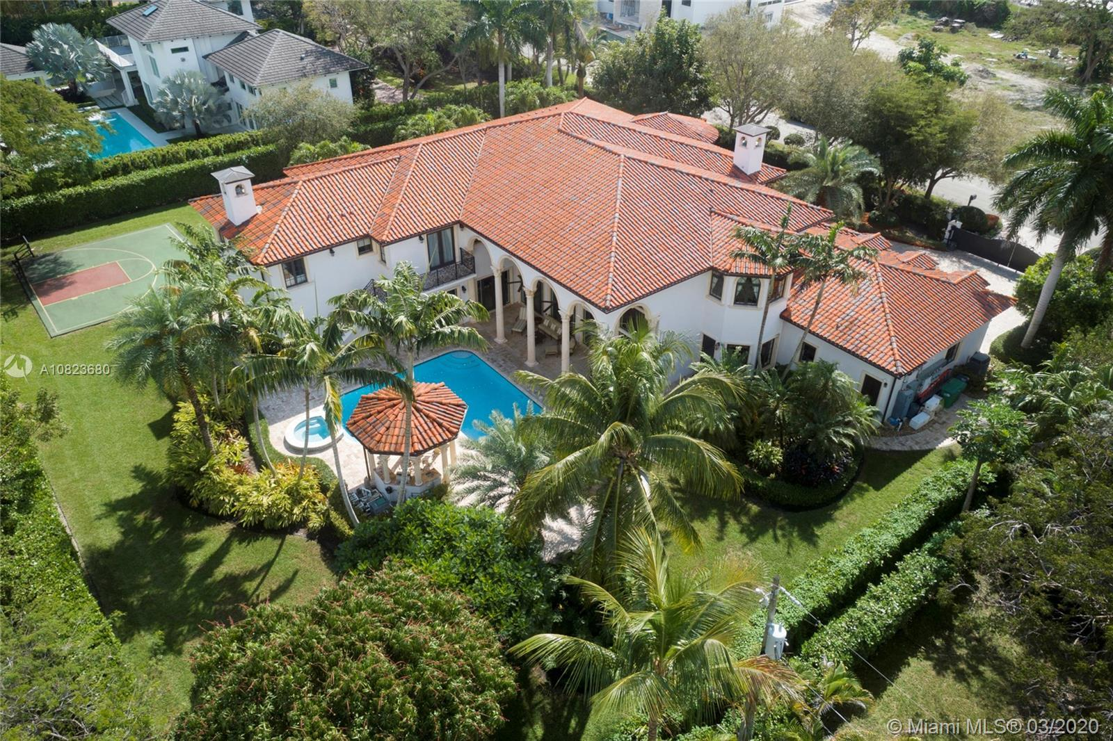 Significant Pinecrest gated estate that is much more than just a home - it's a lifestyle. Beautifull