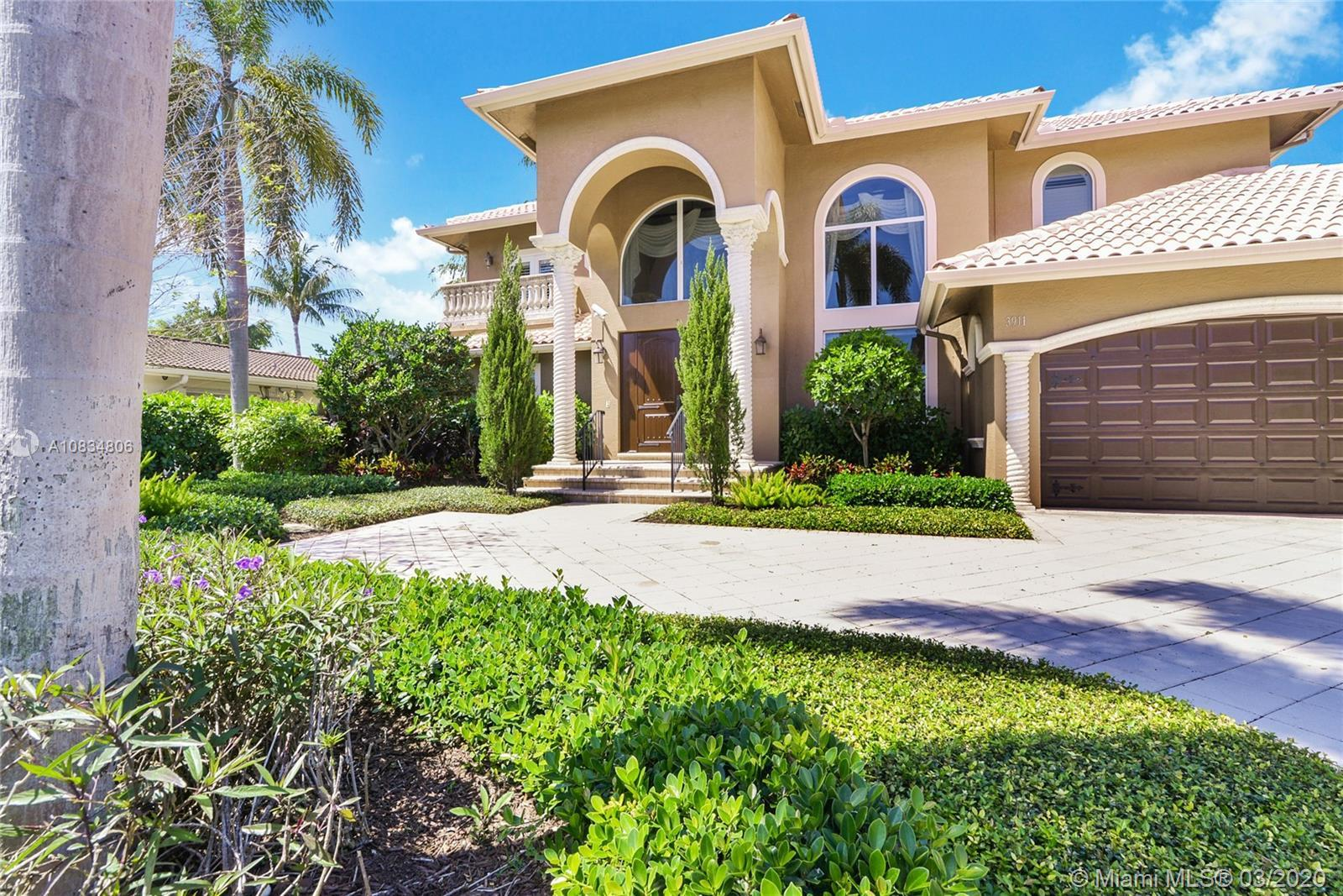 Beautiful home in the highly desirable Venetian Isles section of Lighthouse Point with East exposure