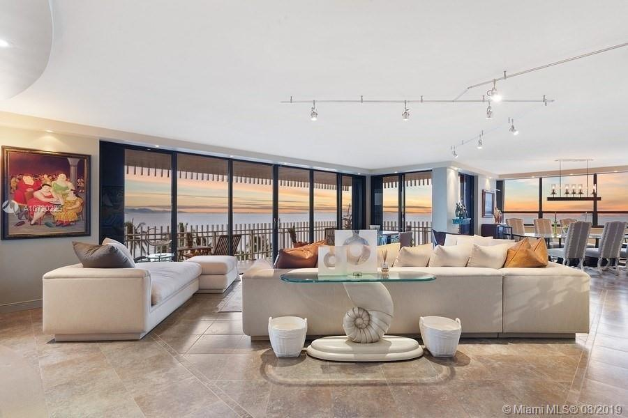 This professionally designed, extraordinary corner-unit with panoramic views of Biscayne bay offers