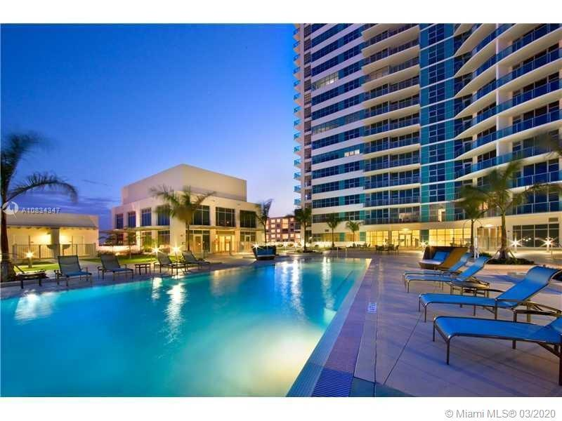 Modern and unique, is all you need!! Enjoy this open space tri-leveled Pent house,  which offers 26