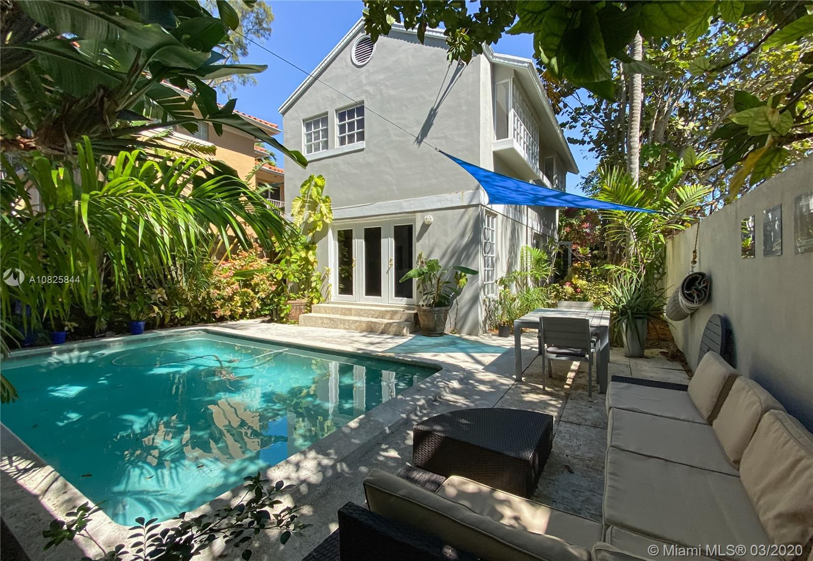 Welcome to paradise! One of a kind walled and gated free-standing townhome with large swimming pool