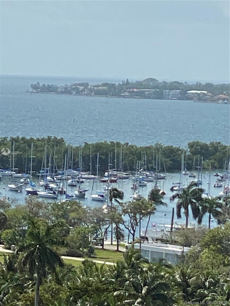 Amazing unit in select Coconut Grove boutique building. Breathtaking bay views and city views. Floor