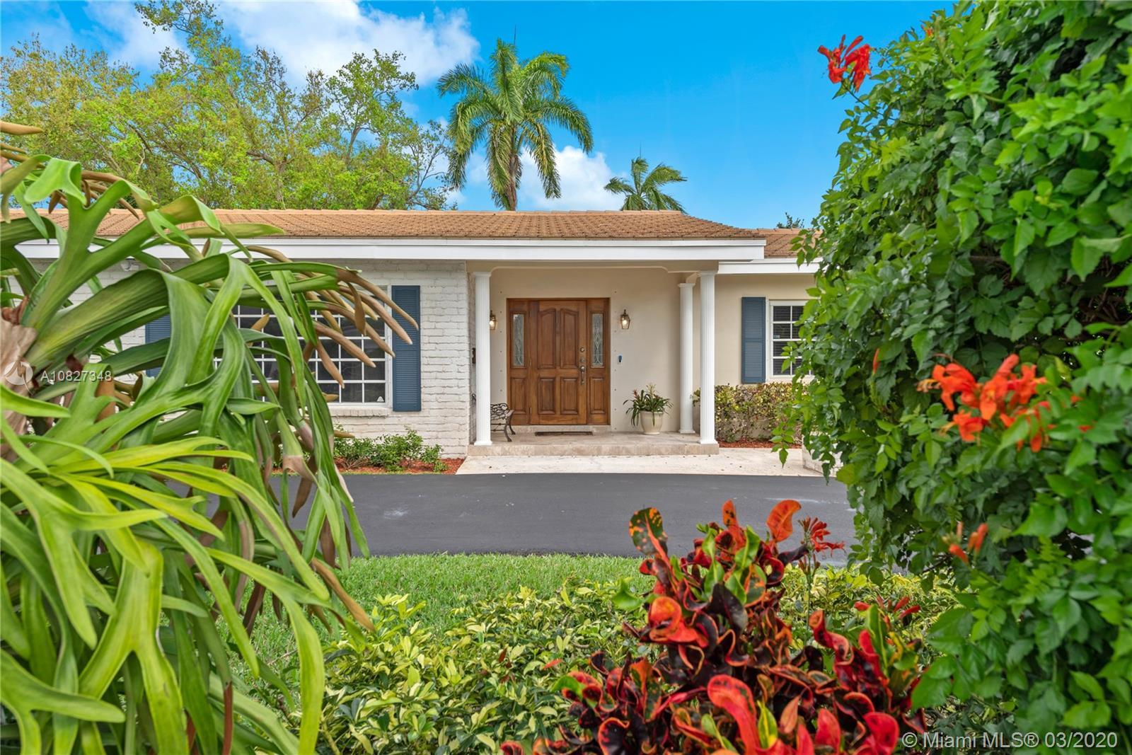 This pristine Mid-Century home in the heart of Pinecrest is move-in ready with recently updated plum