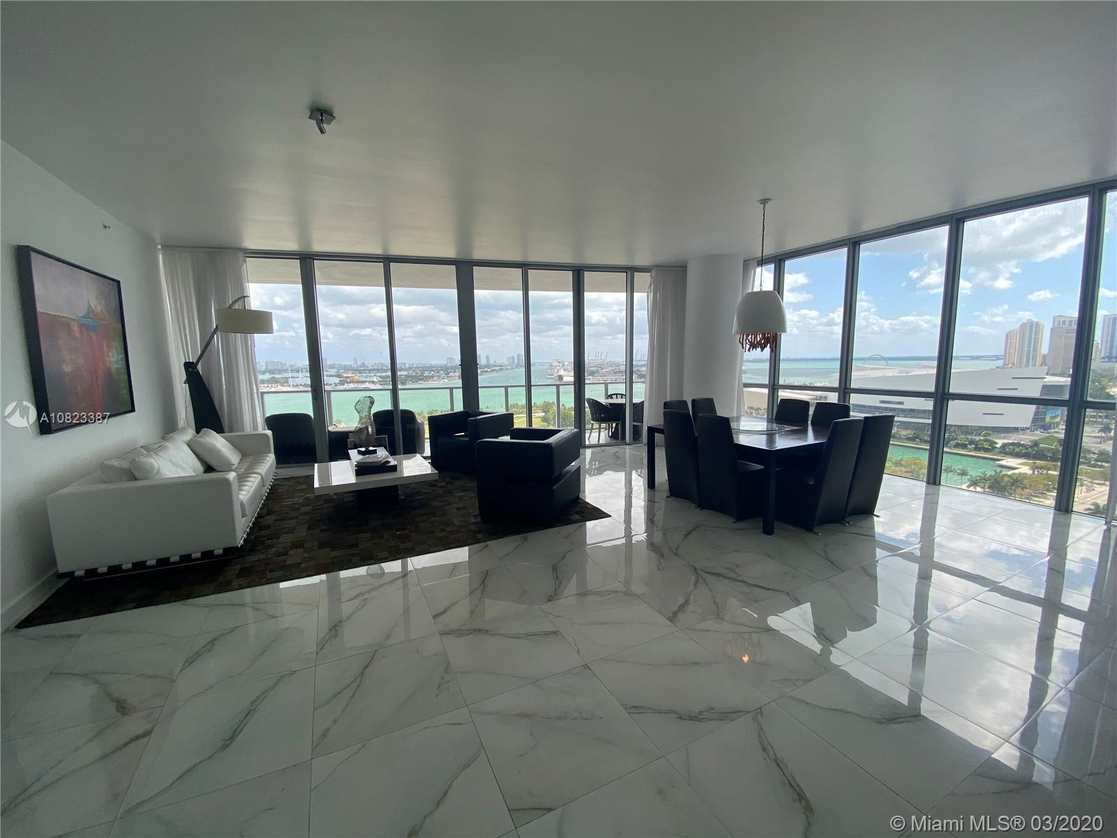 VIEWS! VIEWS! And more GORGEOUS VIEWS! Beautiful corner unit has stunning views of the Miami Skyline
