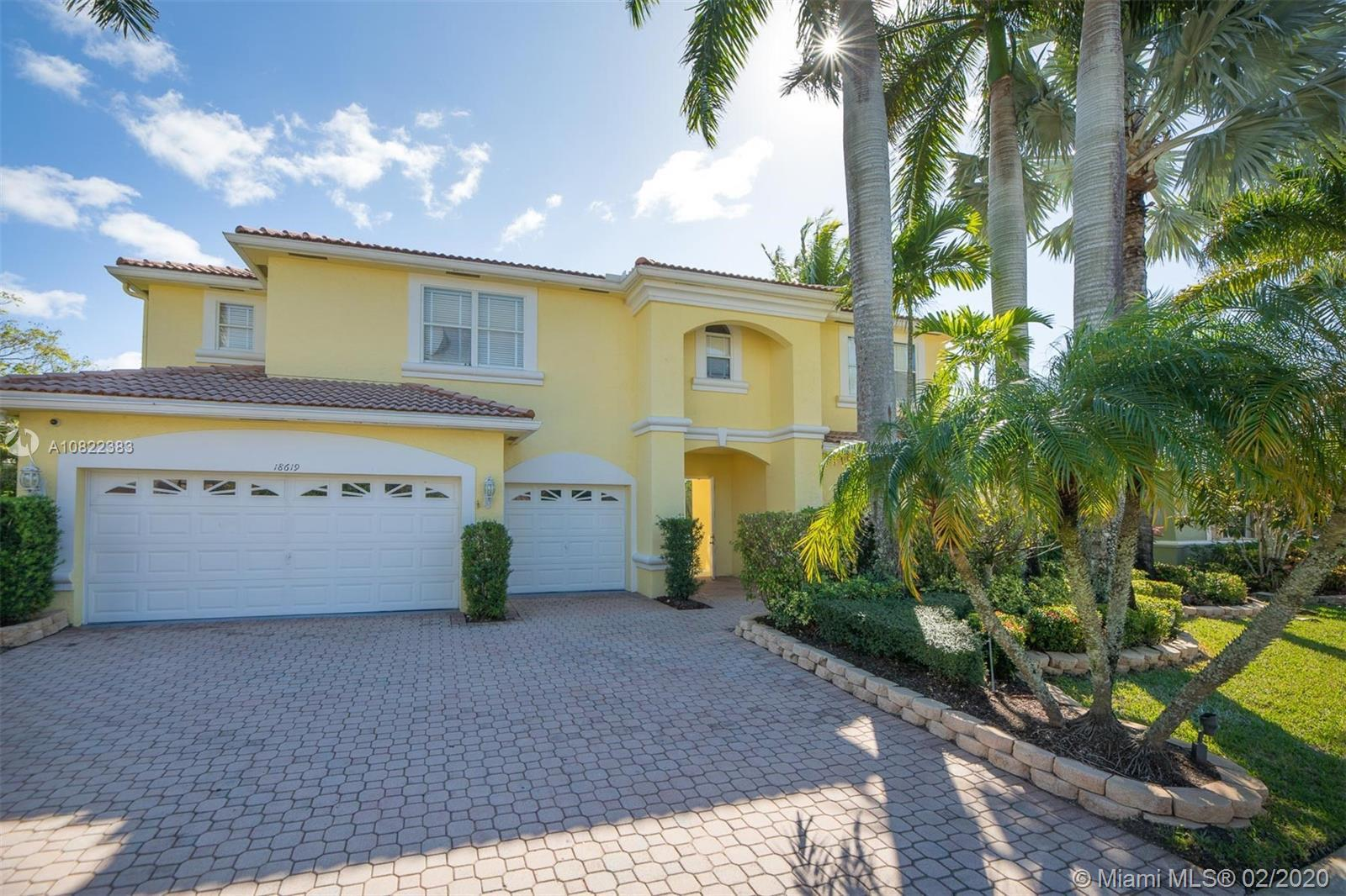 Large two story lakefront pool home with courtyard entrance in gated community. Master bedroom and g