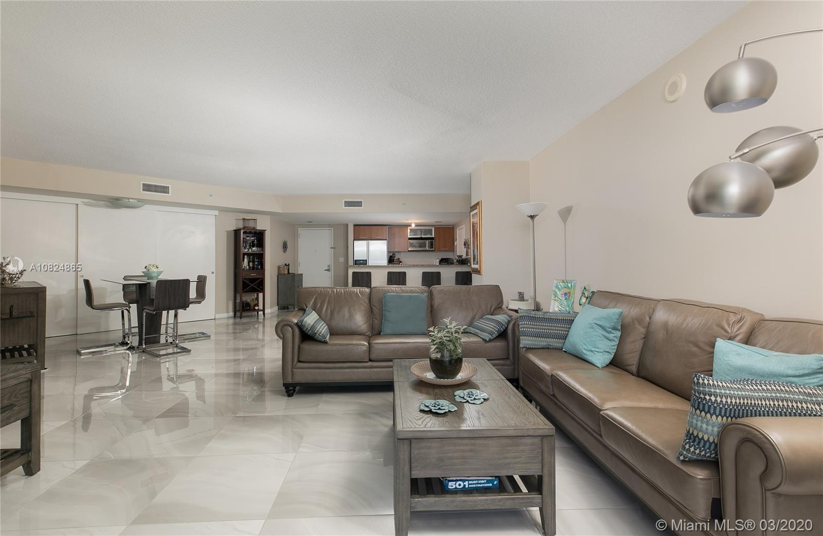 Tastefully remodeled 2/2 in luxurious building with striking views of the city is an elevator ride a