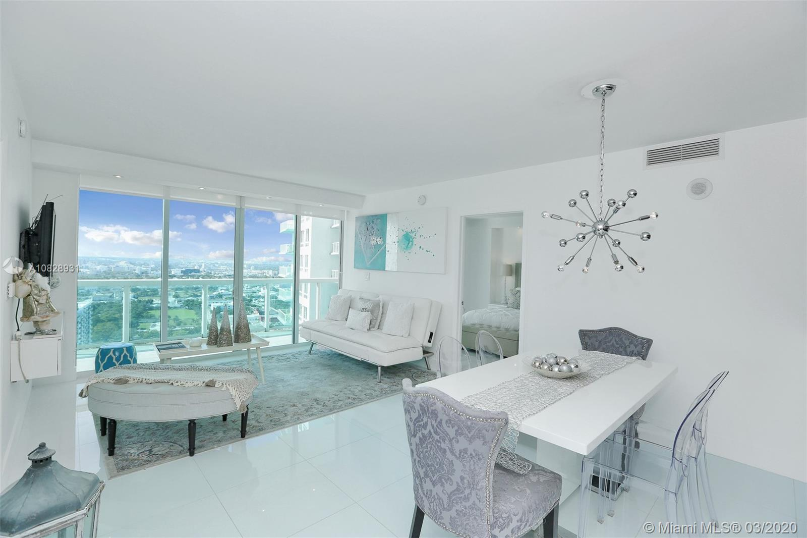 SPECTACULAR SPLIT FLOOR PLAN UNIT FULLY REMODELED TO THE FINEST STANDARDS WITH MAGNIFICENT PANORAMIC