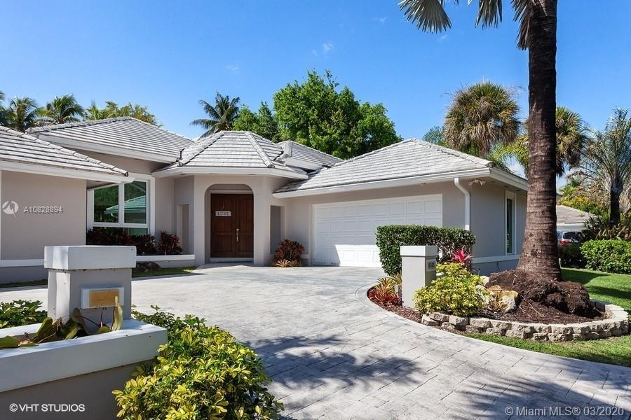 Highly sought after gated community of Arabesque in north Pinecrest. This 4 bedroom 3.5 bath plus an