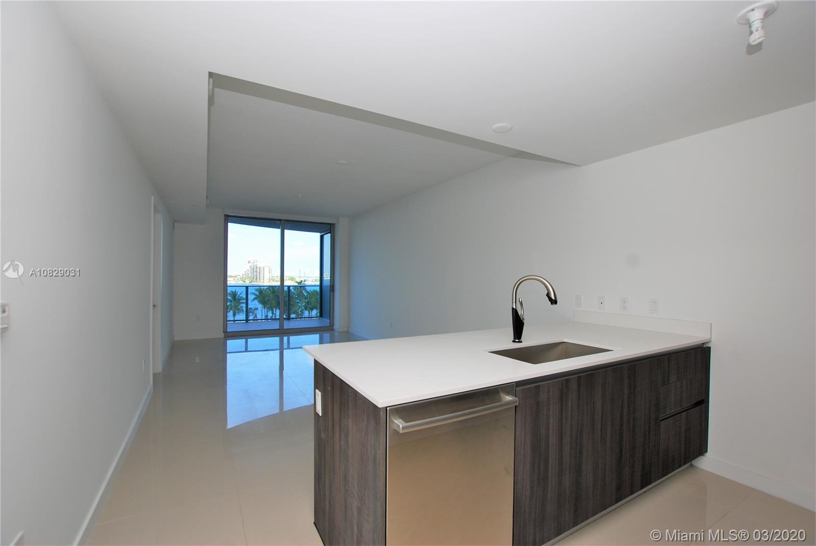 This spectacular 1bed/1.5bath unit is one of the very units in Aria on the Bay with 100% direct bay