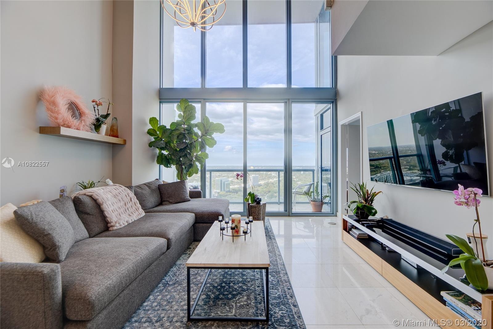 Rare Penthouse Duplex with Incredible unobstructed Miami Bay views.  Dramatic 20'double height ceili