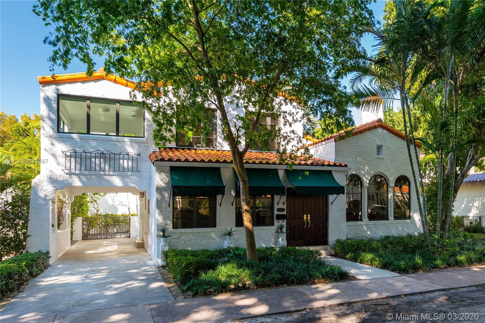 2 beautiful homes for the price of one! This turn-key, charming 1920's spacious Old Spanish 3/2 main