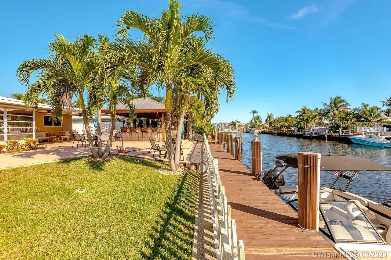 Grand canal front home on 75 feet of waterfront with a 60 ft private dock, ocean access and a huge o