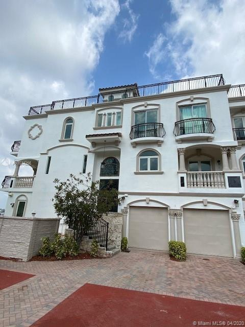 This Spectacular one of a kind gated townhouse is located directly at the Hillsboro Inlet with a pri
