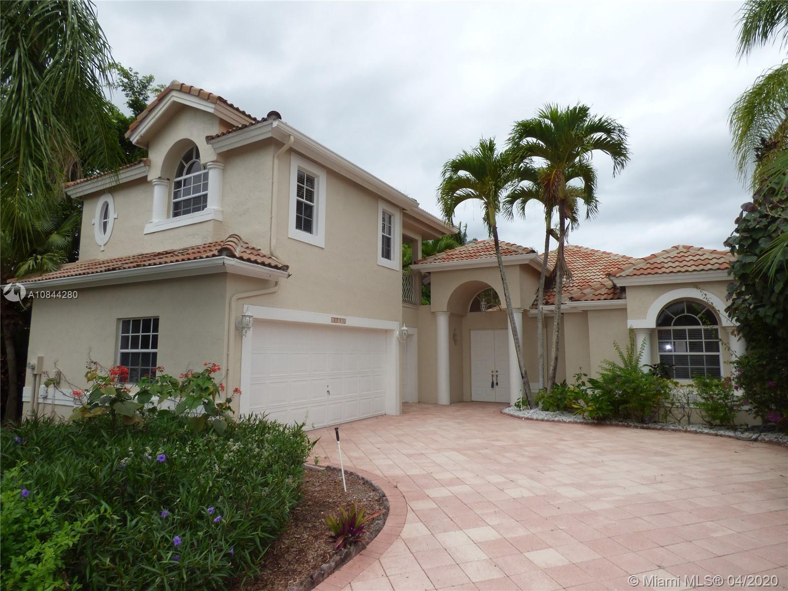 Tranquil Courtyard home with private pool in highly rated Wycliff Community.  Main house features sp
