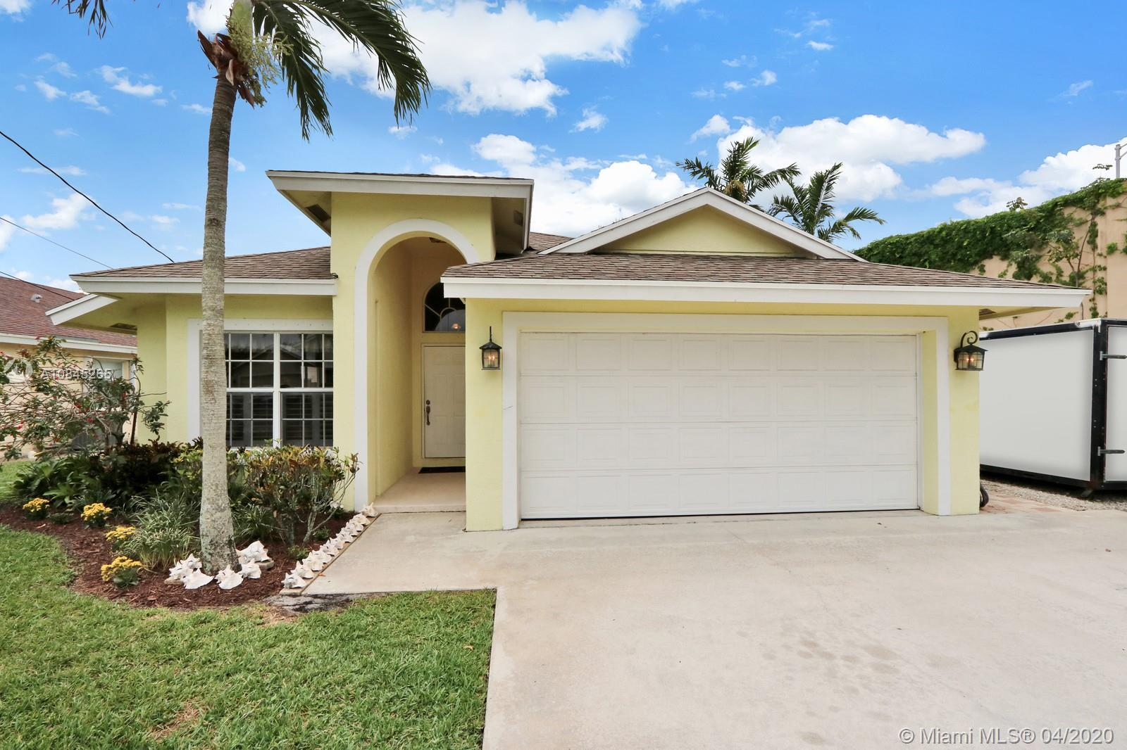 A rare find in the heart of Jupiter. This beautiful home sits on a double lot, in the Heights of Jup