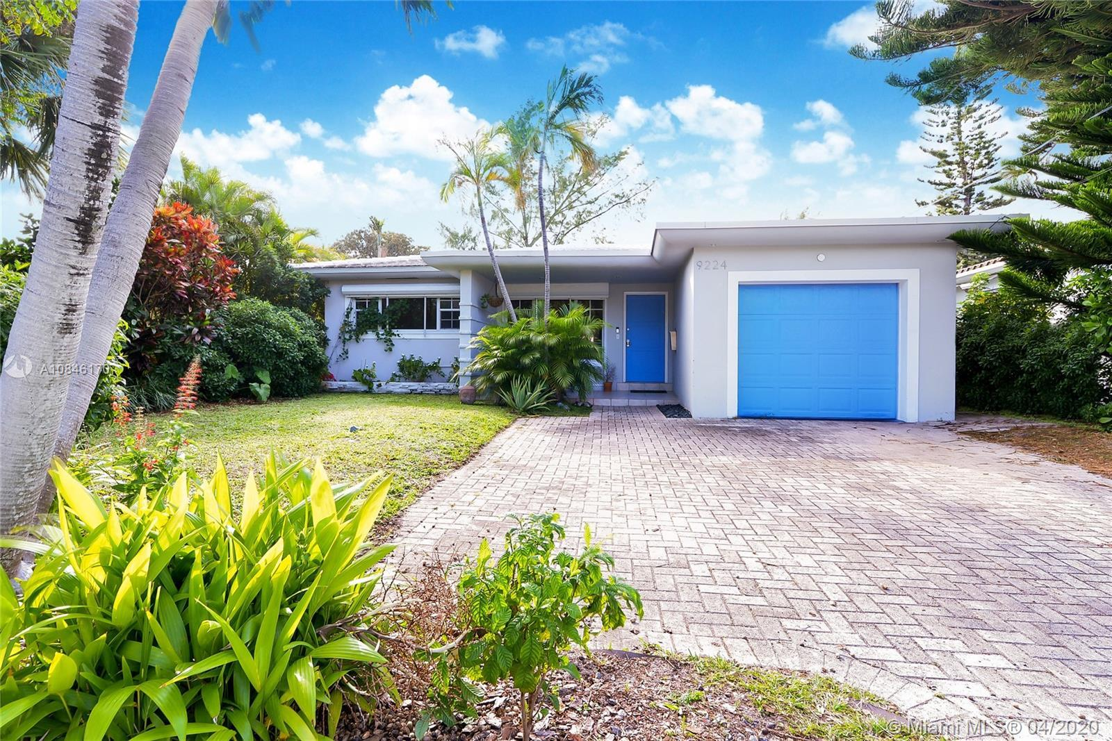 Stylishly renovated and spacious modern house with 3 large bedrooms, 2 bathrooms, a Florida room, an